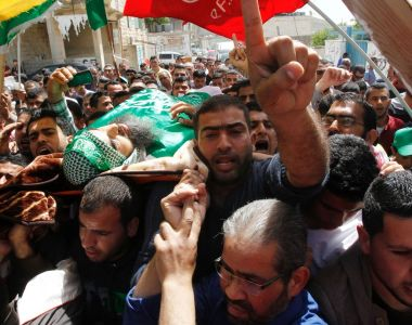 Mourners carry the body of Palestinian Ibrahim al-Gharooz Baradeah, who was killed  in a reported attack  on an Israeli soldier. HAZEM BADER/AFP/Getty Images
