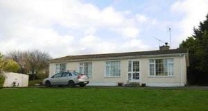 REA Stokes & Quirk is seeking €150,000 for this three-bedroom bungalow on half an acre in Fethard, Co Tipperary