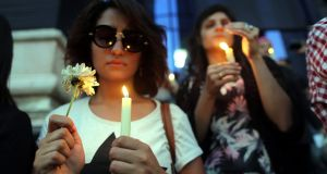 Egyptian journalists light candles during a candlelight vigil for the victims of EgyptAir flight 804, in front of the Syndicate of Journalists in downtown Cairo, Egypt, 24 May 2016. Photograph: Khaled Elfiqi/EPA
