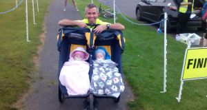Jamie Killeen with his children, Adam and Sadie: while Jamie runs, his babies get to see the world around them . . . at speed.