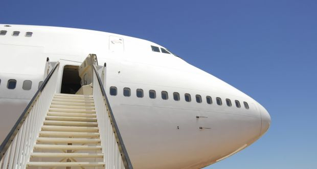 Woman broke wrist after falling from steps up to plane
