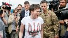 Ukrainian servicewoman Nadiya Savchenko arrives  to a hero's welcome at Boryspil International airport outside Kiev. Photograph: Gleb Garanich/Reuters