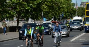 Cycling along the south quays, in Dublin. File photograph: Dara Mac Dónaill/The Irish Times
