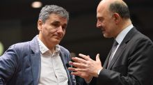 Greece's finance minister Euclid Tsakalotos and European commissioner for Economic and Financial Affairs, Taxation and Customs Pierre Moscovici during an Ecofin meeting in Brussels on Wednesday. Photograph: Emmanuel Dunand/AFP/Getty