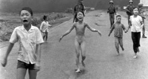 Kim Phuc, centre with her clothes torn off, flees with other South Vietnamese children after a misdirected aerial napalm attack on suspected Viet Cong on June 8th, 1972. Photograph: ap photo/nick ut