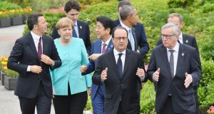 From left, Italian prime minister Matteo Renzi, German chancellor Angela Merkel, Canadian prime minister Justin Trudeau, Japanese prime minister Shinzo Abe, French president Francois Hollande, US president Barack Obama, British prime minister David Cameron (hidden), European Commission president Jean-Claude Juncker and European Council president Donald Tusk (hidden) walk before a G7 photo session at the Shima Kanko Hotel  in Kashikojima, Japan. Photograph:  Foreign Ministry of Japan via Getty Images