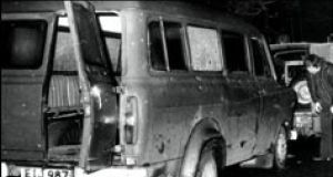 The bullet-riddled minibus which had been transporting the 11 Protestant workers who were gunned down as they lined up alongside the vehicle