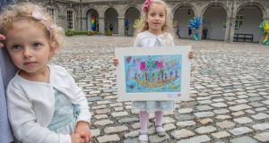 Award winner Alicja Fojk (5) from St Laurence's NS in Sallins, Co Kildare, with her sister Emilia (3), at the 62nd Texaco Children's Art competition awards announced at the IMMA, Dublin. Photograph: Brenda Fitzsimons/The Irish Times