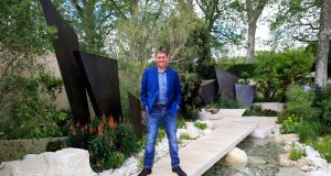 Designer Andy Sturgeon  in his creation the Telegraph Garden, which was named best show garden at the 2016 RHS Chelsea Flower Show. Photo:  Jonathan Brady/PA Wire