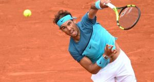 Spain's Rafael Nadal serves  to Argentina's Facundo Bagnis during their  second round match at the Roland Garros. Photograph: Martin Bureau/AFP/Getty Images