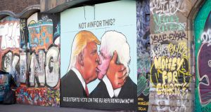 A mural  on a derelict building shows  US presidential hopeful Donald Trump sharing a kiss with former London Mayor Boris Johnson. Photograph:  Matt Cardy/Getty Images