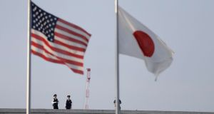 Japanese policemen on top of the Hiroshima Peace Memorial Museum behind the US and Japanese flags: Barack Obama visited Hiroshima and made a plea for nonproliferation of nuclear weapons. Photograph: Kiyoshi Ota