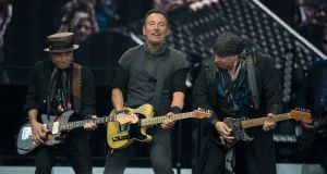 Bruce Springsteen on stage at Croke Park with band members Nils Lofgren (left) and 'Little Stephen' Van Zandt. Photograph: Dave Meehan/The Irish Times