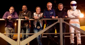 'Top Gear' presenters (from left to right): Chris Harris, Rory Reid, Sabine Schmitz, Chris Evans, Eddie Jordan and The Stig, during the launch of the new series of the show at Dunsfold Aerodrome in Surrey, England. Photograph: Andrew Matthews/PA Wire