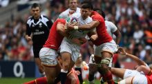 Ben Youngs of England is wrapped up by the Welsh defence during the Old Mutual Wealth Cup  at Twickenham. Photograph:   Mike Hewitt/Getty Images