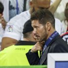 Atlético Madrid coach Diego Simeone collects his runners-up medal at the San Siro stadium in Milan. Photograph: Images
