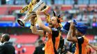 Hull City's David Meyler celebrates with the playoff  trophy at Wembley. Photograph: Nigel French/PA Wire.