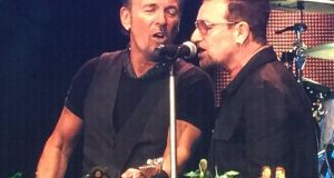 Bono joins Bruce Springsteen on stage at Croke Park. Photograph: @fdomenella/Twitter