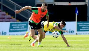 Daryl Murphy leaves Shane Long in his wake during Ireland's training session at Turner's Cross, Cork yesterday. Photograph: Donall Farmer/Inpho