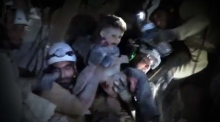 The moment rescuers pull a child from rubble after Idlib airstrike