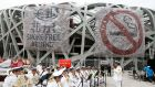 A band performs as large banners with anti-smoking messages hang from the Bird's Nest Stadium during a programme to mark World No Tobacco Day in Beijing on Monday. Photograph: Rolex Dela Pena/EPA