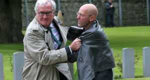 Canadian ambassador to Ireland Kevin Vickers tackles a protester who attempted to disrupt proceedings during a State ceremony to remember the British soldiers who died during the Easter Rising, at Grangegorman Military Cemetery. Photograph: Colin Keegan/Collins Dublin