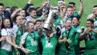Bundee Aki lifts the Pro12 trophy as the Connacht players celebrate their win over Leinster. Photograph: James Crombie/Inpho