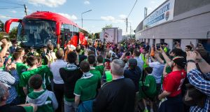 Supporters welcome the Republic of Ireland team bus at Turner's Cross. Photo: Cathal Noonan/Inpho