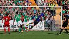 Mikhail Hardzeichuk of Belarus scores his side's first goal against Ireland at Turners Cross. Photo: Donall Farmer/Inpho
