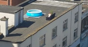 The good weather has prompted employees in a building on Tara Street to get an inflatable pool for the roof. Photograph: Paddy Logue/The Irish Times