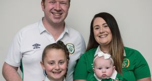 Pictured is Eoin McCann, with his wife Roisin, and daughters Emma (9) and Aoife (4 months). Photograph: Dave Meehan/The Irish Times