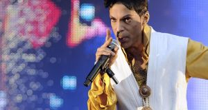 Prince performing on stage at the Stade de France outside Paris in 2011. Photograph: Bertrand Guay/AFP/Getty Images