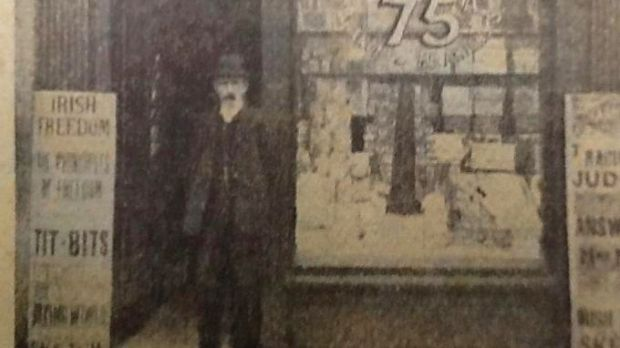 """The 1916 leader Tom Clarke stands in the doorway of his shop on Great Britain (now Parnell) Street, looking the very picture of a nationalist revolutionary."""