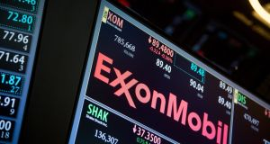 Exxon Mobil Corp. signage is displayed on a monitor on the floor of the New York Stock Exchange. The S&P 500 fell 0.2 per cent, after losing as much as 0.5 per cent. The Dow Jones Industrial Average declined 0.1 per cent, to 17,771.62. The Nasdaq Composite slipped 0.2 per cent. (