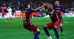 Barcelona's Jordi Alba  celebrates scoring their opening goal with teammates Neymar and Lionel Messi the Copa del Rey Final match between Barcelona and Sevilla. Barcelon has topped the sponsorhip league.
