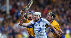Clare's Podge Collins  tackles Waterford's Shane Bennett during the league final replay. Photograph: Cathal Noonan/Inpho