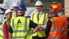 "Chancellor George Osborne meets workers during a visit to Warrenpoint Harbour in Co Down, where he warned that Brexit would trigger a ""profound economic shock"" in Northern Ireland and result in an inevitable hardening of the Irish border. Photograph: Brian Lawless/PA Wire"