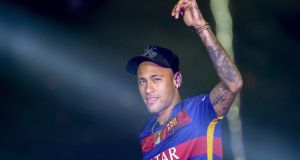Barcelona's Brazilian forward Neymar  at the Camp Nou stadium in Barcelona, Spain. Spanish prosecutors have called for Brazilian soccer player Neymar to stand trial for fraud. File photograph: Josep Lago/AFP/Getty Images