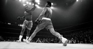 Joe Frazier, left, in a boxing match against Muhammad Ali at Madison Square Garden in New York, in 1971. Photograph: Larry Morris/The New York Times