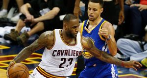LeBron James holds off Stephen Curry during the NBA Finals game three. Photograph: Epa
