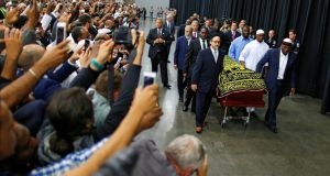 Worshipers and well-wishers look on as the body of the late boxing champion Muhammad Ali is brought for his jenazah, an Islamic funeral prayer, in Louisville, Kentucky. Photograph: Carlos Barria/Reuters