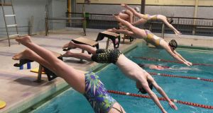 Members of the City of Derry Swim Club team  during an early morning training session. Photograph: Trevor McBride