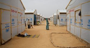 Women stand between shelters at Maiduguri's Bakasi government camp. Photograph: Sally Hayden