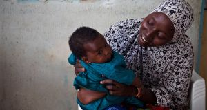 Modu and her baby Fatima in the NYSC camp in Maiduguri, Borno State. Photograph: Sally Hayden