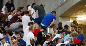 England fans climb over a fence to escape trouble in the stadium after Euro 2016 group B game against Russia  at the Stade Vélodrome in Marseille. Photograph:  Kai Pfaffenbach/Reuters/Livepic