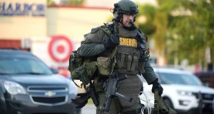 An Orange County Sheriff's Department SWAT member arrives to the scene of a fatal shooting at Pulse Orlando nightclub in Orlando. Photograph: Phelan  Ebenhack/AP