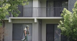 A bomb disposal unit checks for explosives around the apartment building where shooting suspect Omar Mateen is believed to have lived on Sunday. Photograph:   Joe Raedle/Getty Images