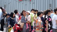 People queuing at the Disney store in the Pudong financial district in Shanghai: China's corporate debt risks sparking a bigger crisis if the authorities fail to tackle it, the International Monetary Fund has warned. Photograph:  Aly Song