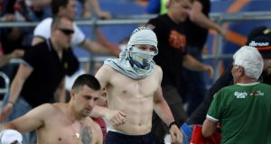 Fans run from the stadium following clashes between Russian and English supporters. Photograph: AFP/Getty Images