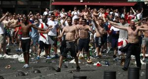 England fans throw bottles and clash with police ahead of the Euro 2016 Group B game against Russia in Marseille. Photograph:  Carl Court/Getty Images.
